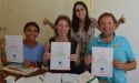 Students gaining their certificates after their french summer class,
