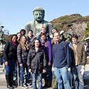 Students having their picture taken with the Great Buddha Kamakura in Japan