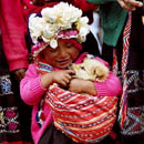 A child carrying a puppy in Bolivia
