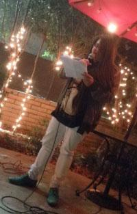 Jax reading her poetry aloud while studying abroad in Paris.