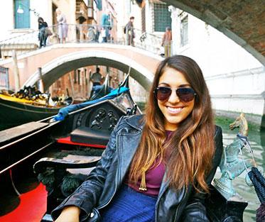 Liza enjoying the waterways of Venice on a weekend excursion.