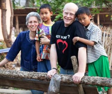 Evelind and her husband Mike with some Thai children