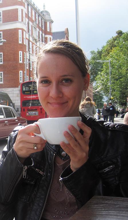Girl drinking tea in England