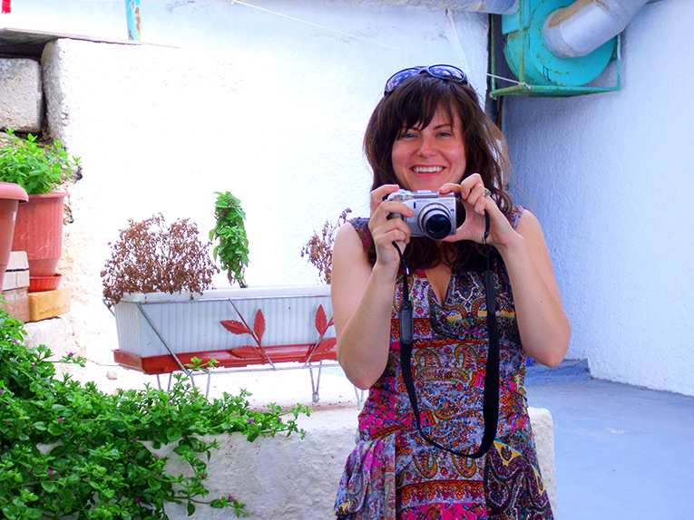 Woman taking a picture in Greece