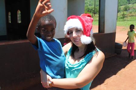 Volunteer with child in Africa at Christmas time