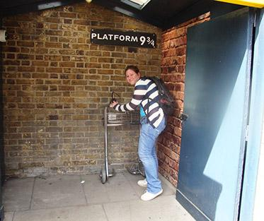 Ronnie in Front of Platform Nine and Three Quarters in London.