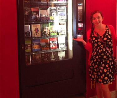 Lucy wondering why they have a book vending machine in a movie theater?