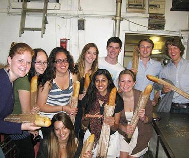 Unnati and her classmates visiting a boulangerie in Paris.