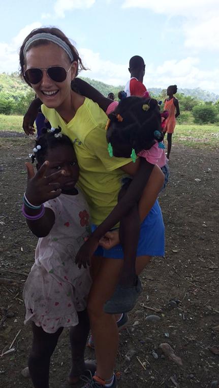 Volunteer with children in Haiti