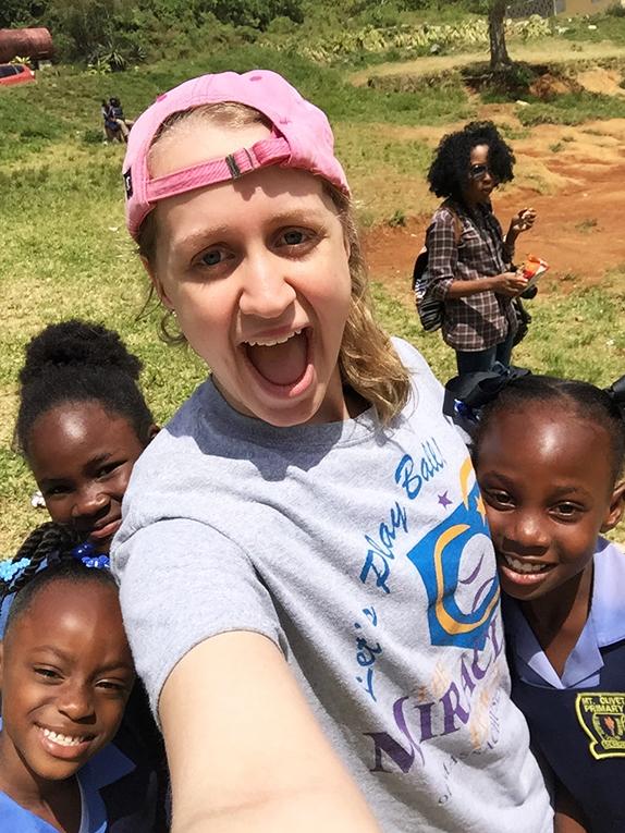Volunteer with school children in Jamaica