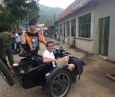 Zach and his tour guide on their ride to the Great Wall of China.