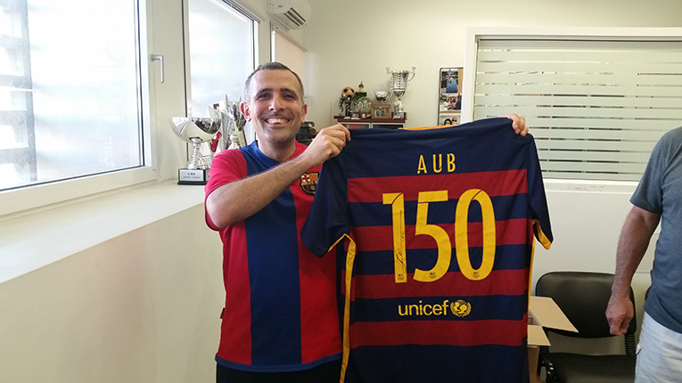 American University of Beirut professor with Barcelona soccer shirt