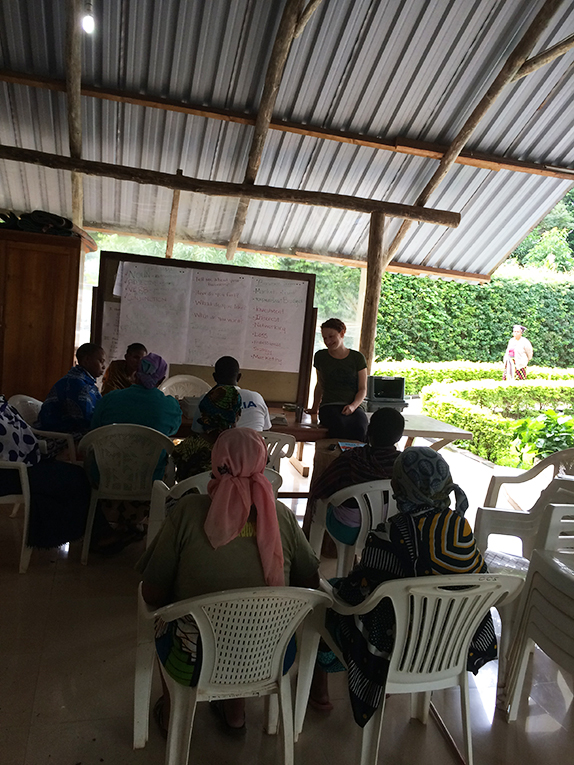 Volunteer teaching English to women in Tanzania