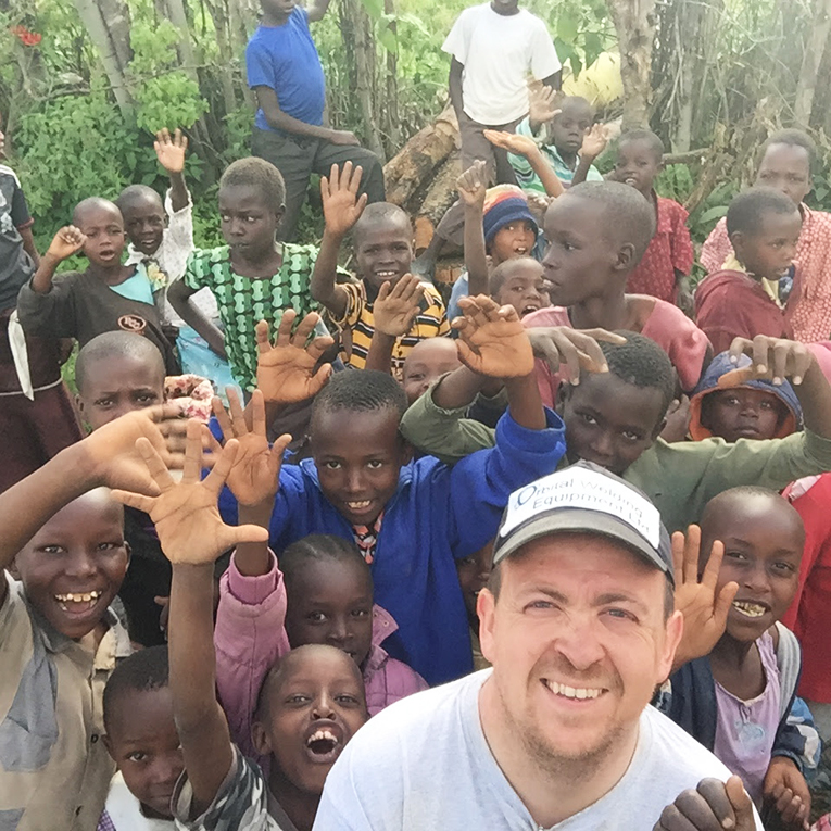 Volunteer with children in Nakuru, Kenya