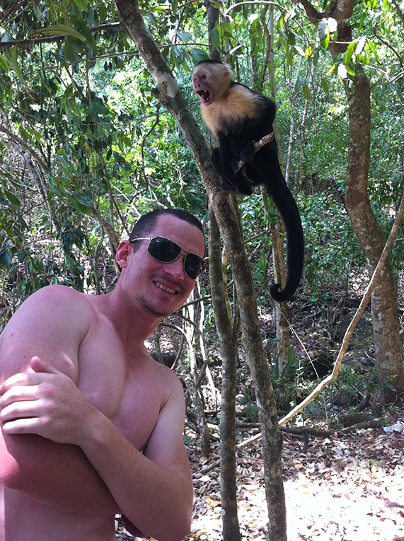 Man with a monkey at Manuel Antonio Park in Costa Rica