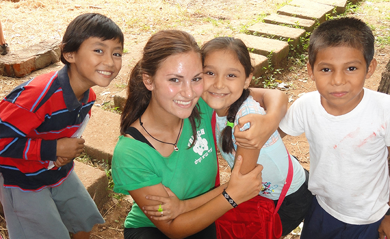 Foreign teacher with students in Nicaragua