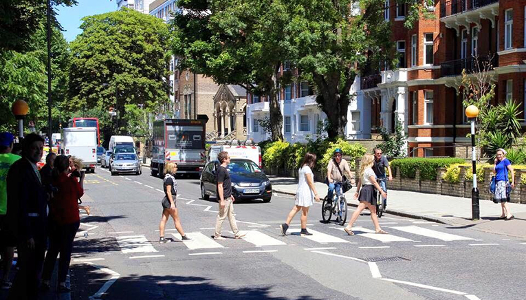 Students walking across Abbey Road in London, England