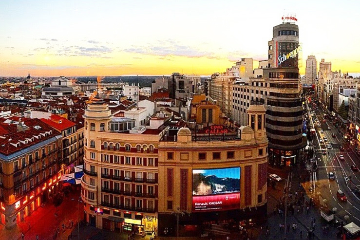 Sunset on the Gran Via in Madrid, Spain