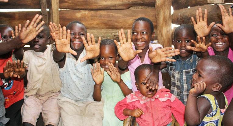 Ugandan children showing off their clean hands