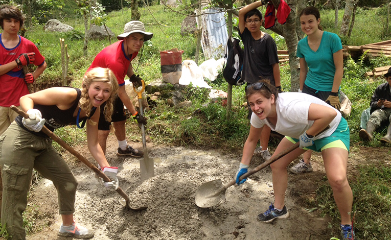 Volunteers mixing cement in Costa Rica
