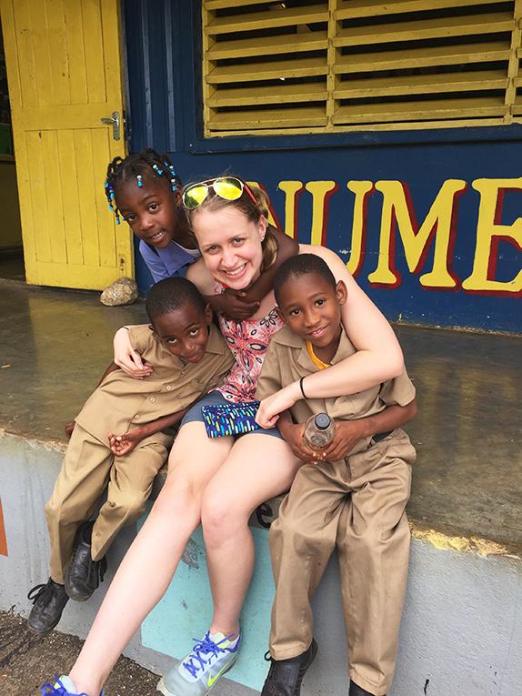 International volunteer with Jamaican students