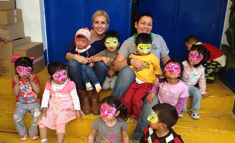 Volunteers with local children in Guatemala