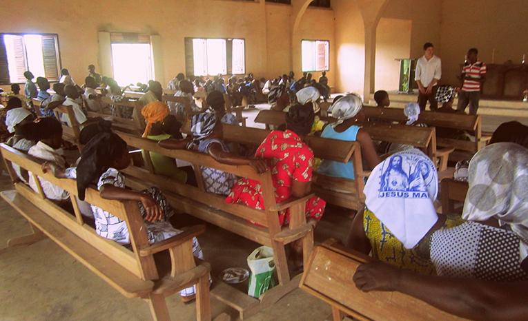 Volunteer doing a presentation at a church in Ghana