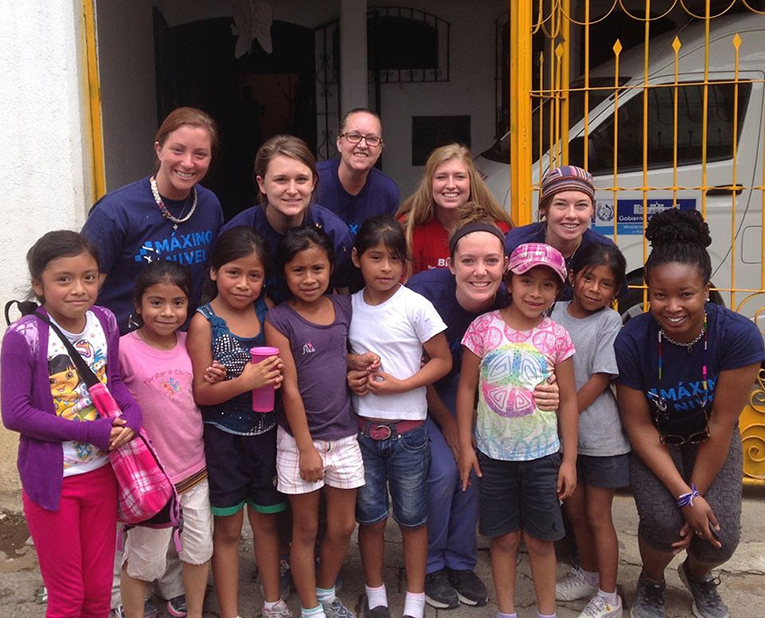 Foreign volunteers with local children in Guatemala