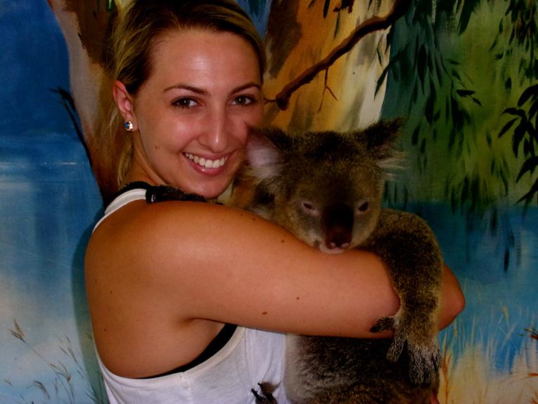 Tourist holding a koala in Cairns, Australia