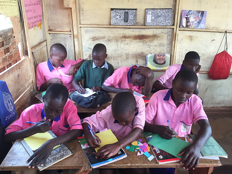 Primary school students in Uganda making cards