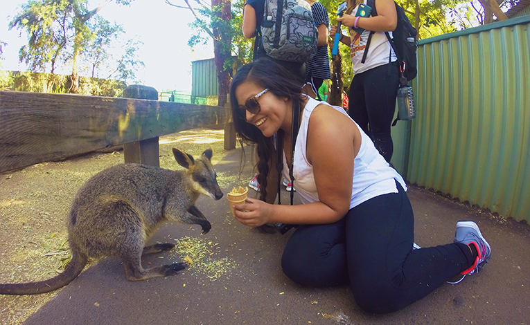 Girl with a wallaby in Australia