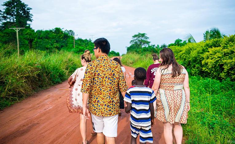 Volunteer teachers with their students in Ghana