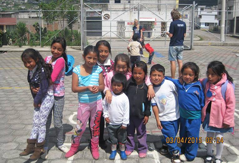 Local children at the Caupichu market in Quito, Ecuador