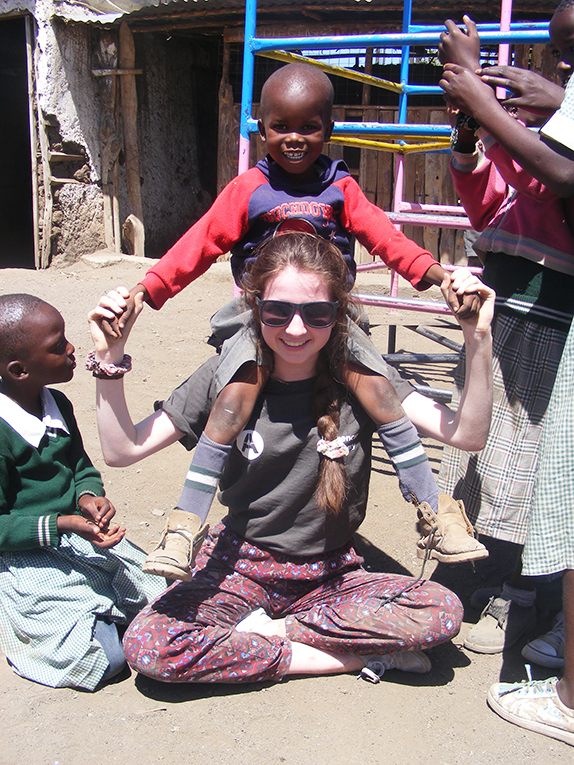 Volunteer playing with a child in Kenya