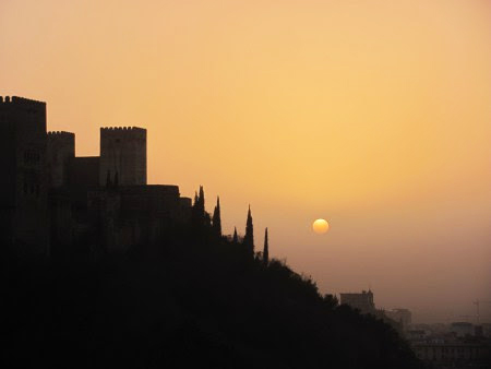 Silhouette of the Alhambra during sunset in Granada, Spain