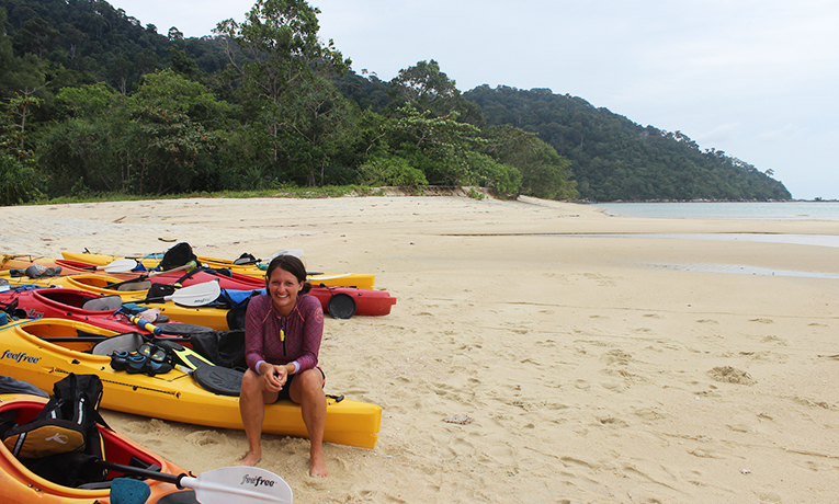 Taking a break from Kayaking on a beach in Southern Thailand
