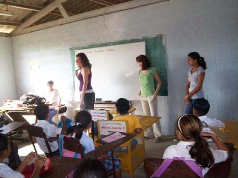 Volunteers teaching abroad in a school