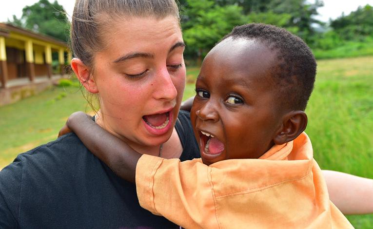 Volunteer teacher says goodbye to a student in Ghana