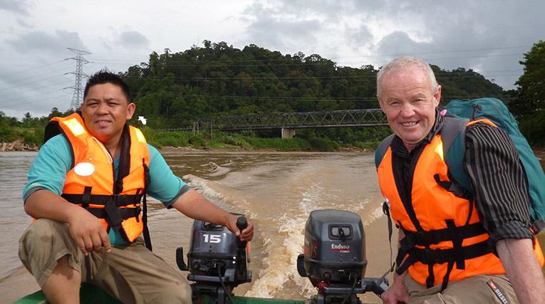 Riding a longboat in Borneo