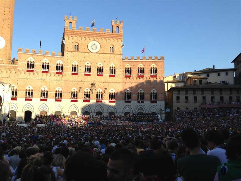Palio di Siena crowd at Piazza del Campo in Siena, Italy
