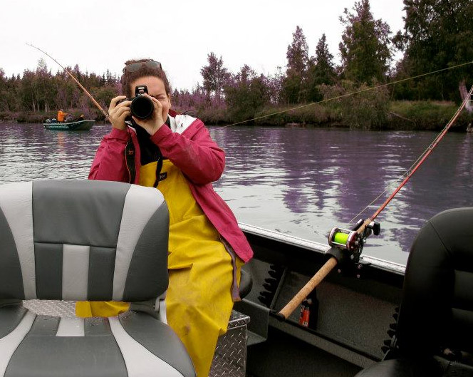 Taking a picture while on a boat, traveling in Alaska