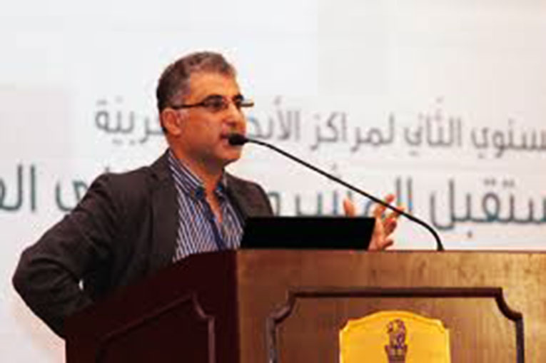 Dr. Sari Hanafi speaking at an event