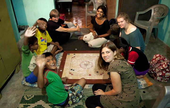 Volunteers playing games with street children in Nepal