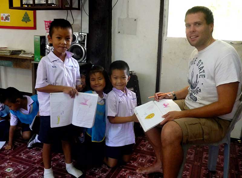 International teacher with elementary school students in Thailand