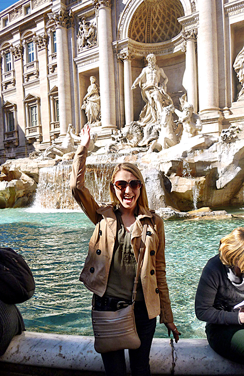 Making a wish at the Trevi Fountain in Rome, Italy