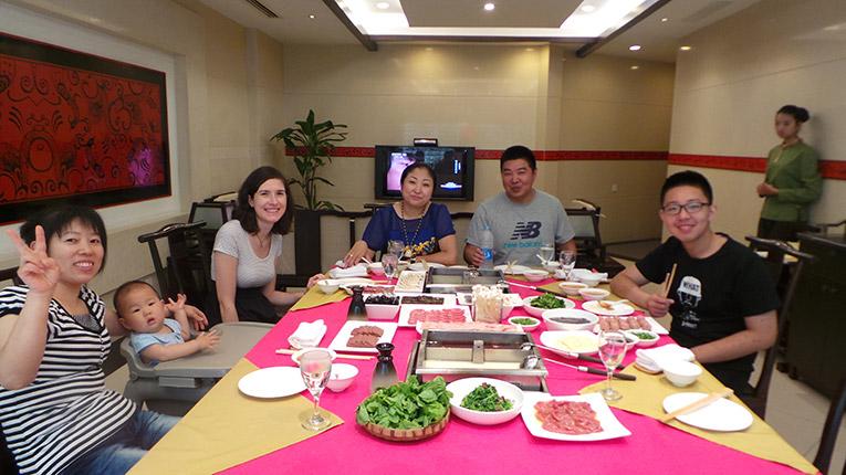 Volunteer having dinner with Chinese Host Family