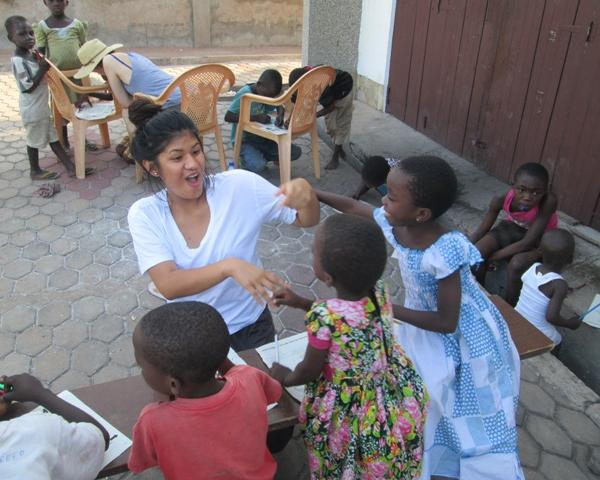 Volunteer having fun with our kids at the orphanage after a normal day work at the hospital