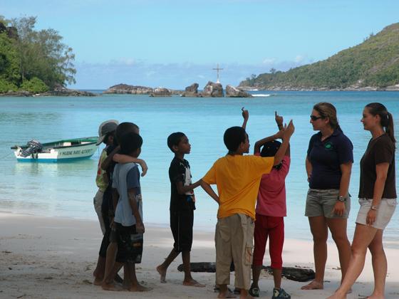 Children excited in an interactive beach activity