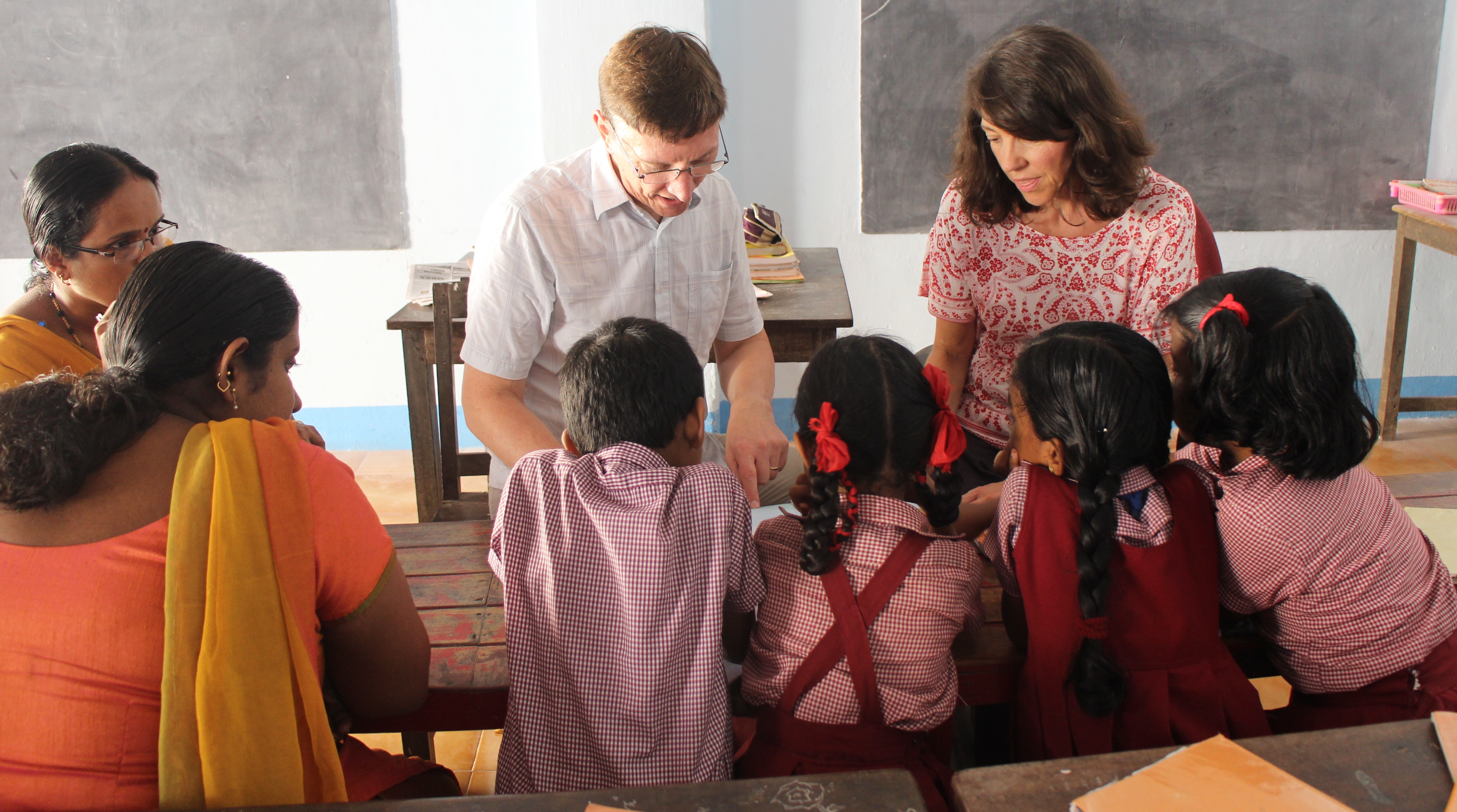 family volunteers teaching children