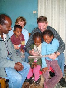 Missionary reads to children in Ethiopia, Africa